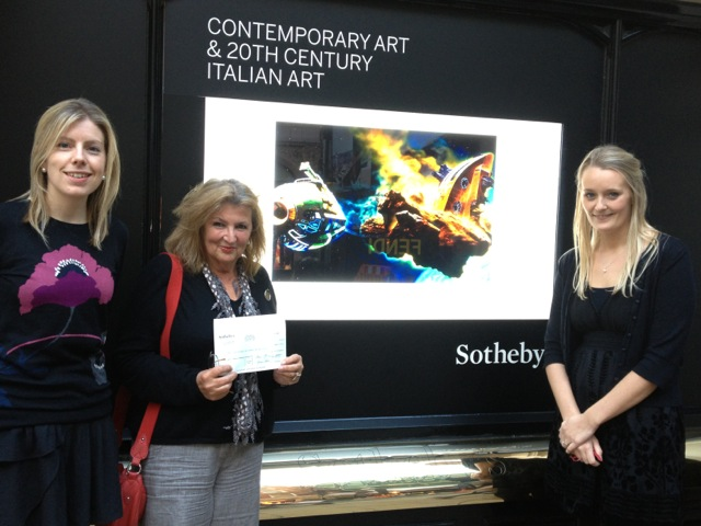 Sotheby's presenting cheque